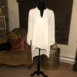 Cream a symmetrical blouse